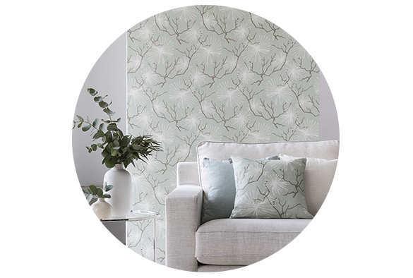 sofà amb coixins fets amb la nova col·lecció de teles colors càlids