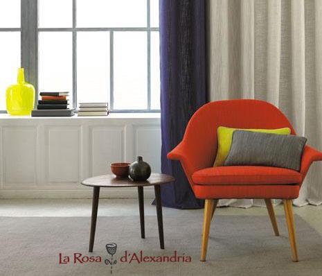 finestra amb cortines per a casa sofà i taula petita logo de la Rosa d'Alexandria